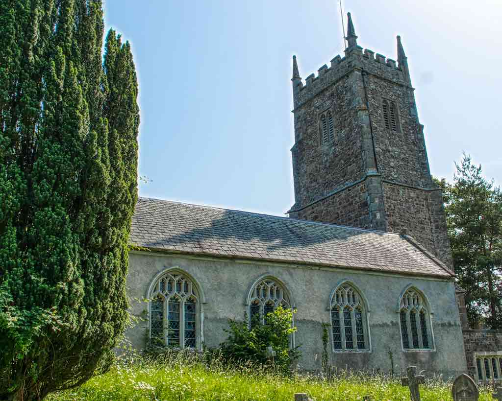 The 15th Century Ashton Church of St John the Baptist sits on a steep bluff overlooking the Teign Valley