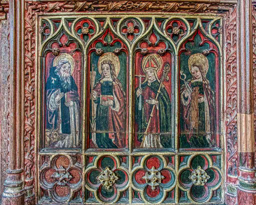 A parade of saints amongst magnificently coloured carving on Ashton rood screen