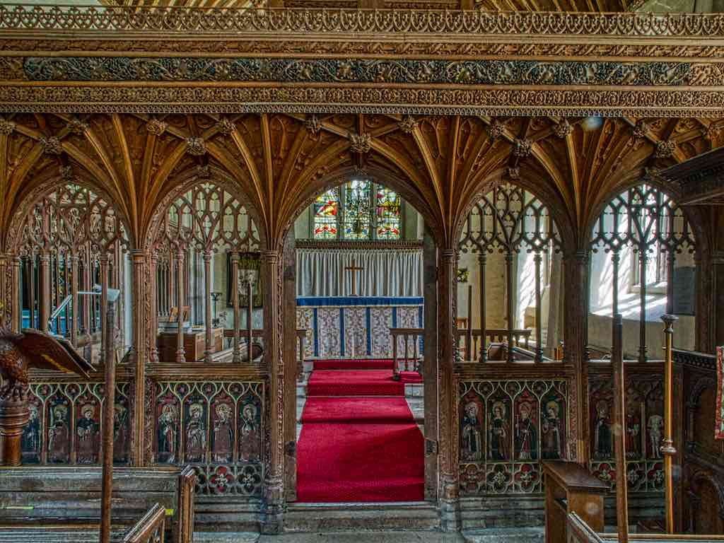 The glorious Ashton rood screen, the vaulting a restoration, the lower part original 15th century