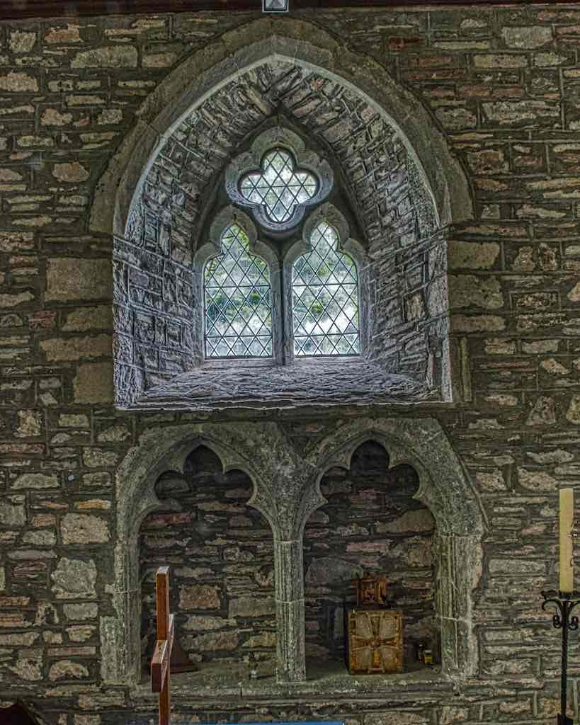 Seats for the clergy and a window from the 1300s