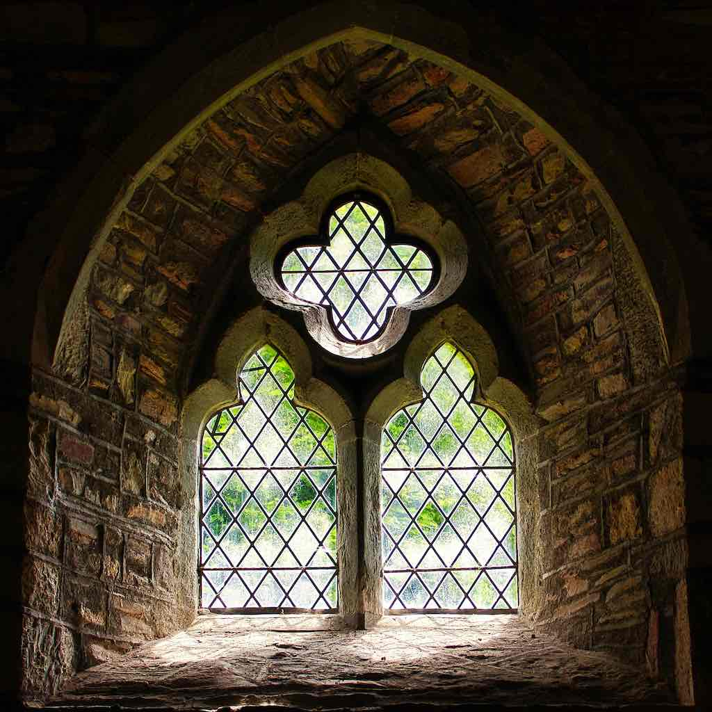 A window from the 1300s in the chancel