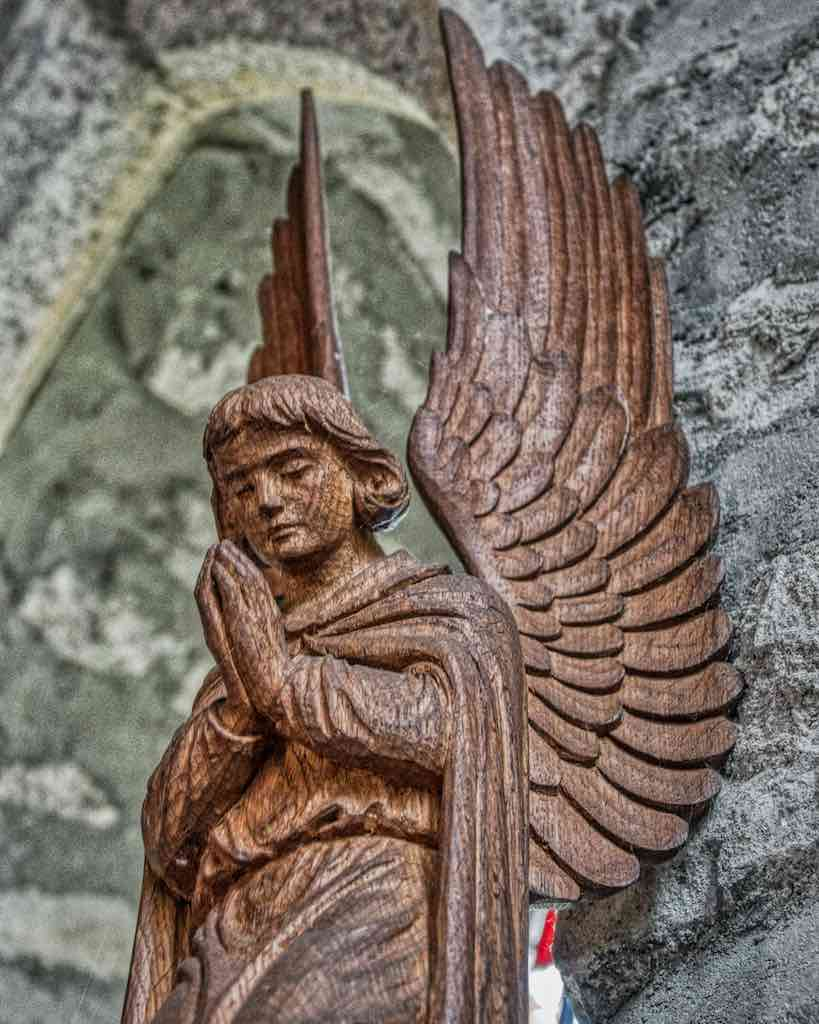 An angel praying above the altar