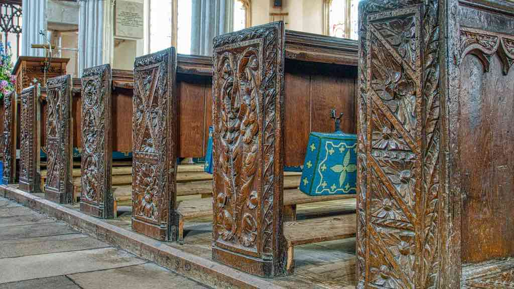 An aisle of 16th century bench ends.