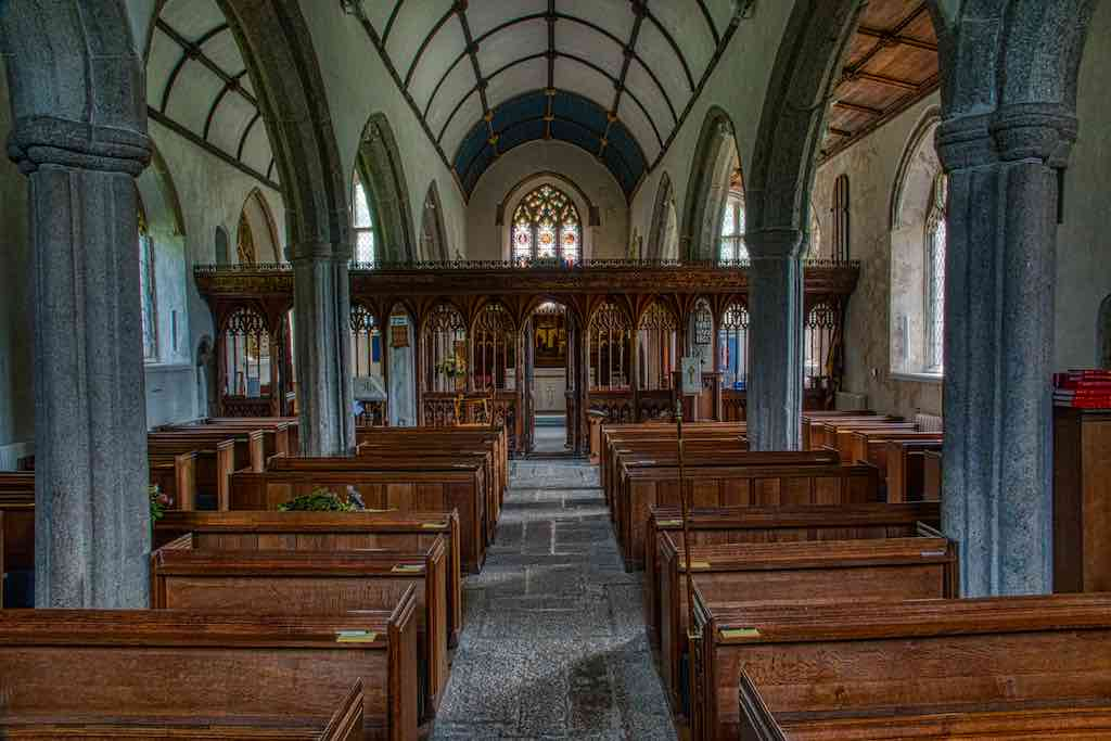 The spacious nave and aisles with the rood screen at the end