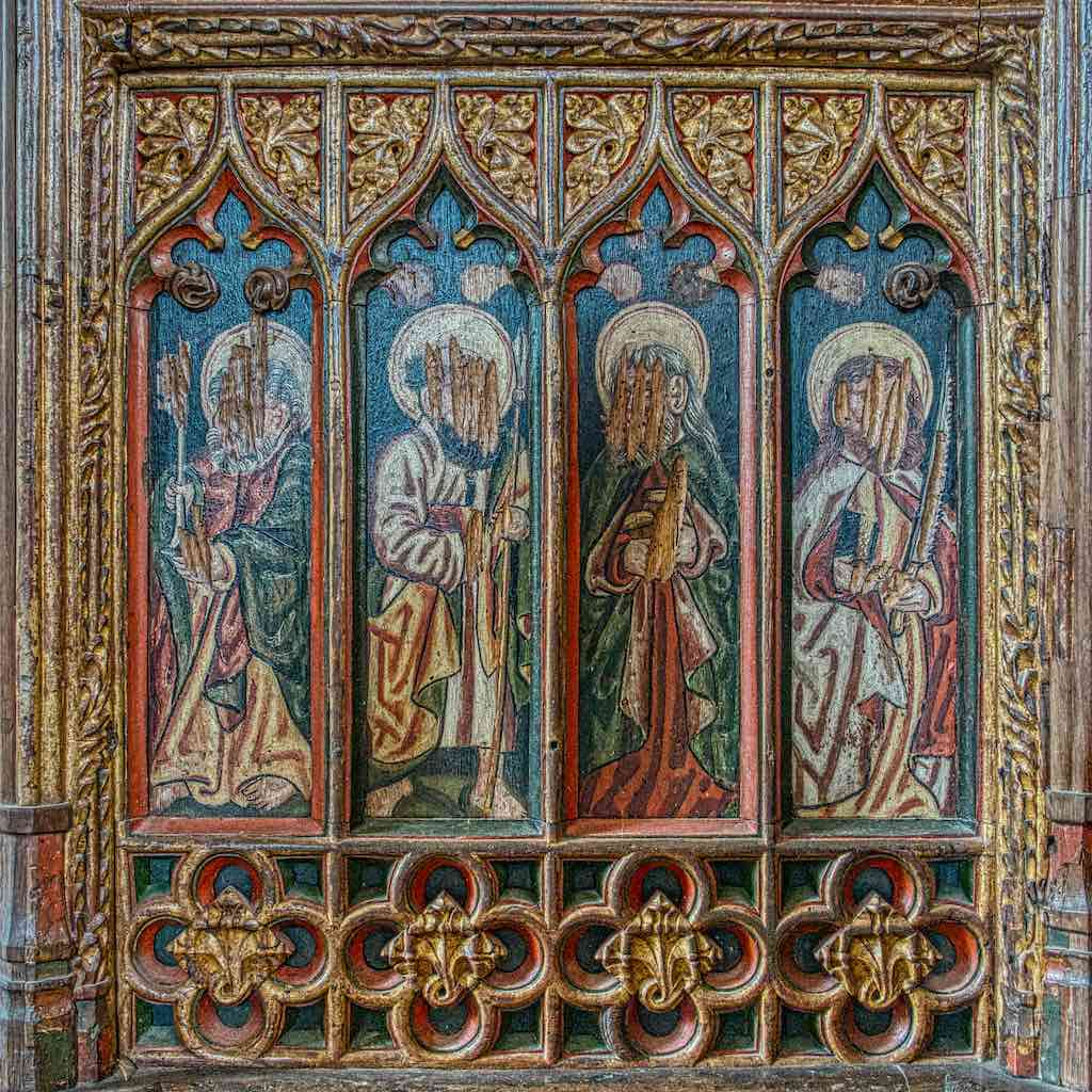 Saints Peter, Thomas, Jude and Simon surrounded by some superb carving