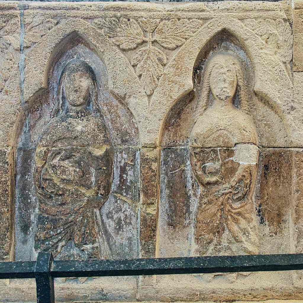 Saint Catherine on the left with her wheel and Mary Magdalene on the right
