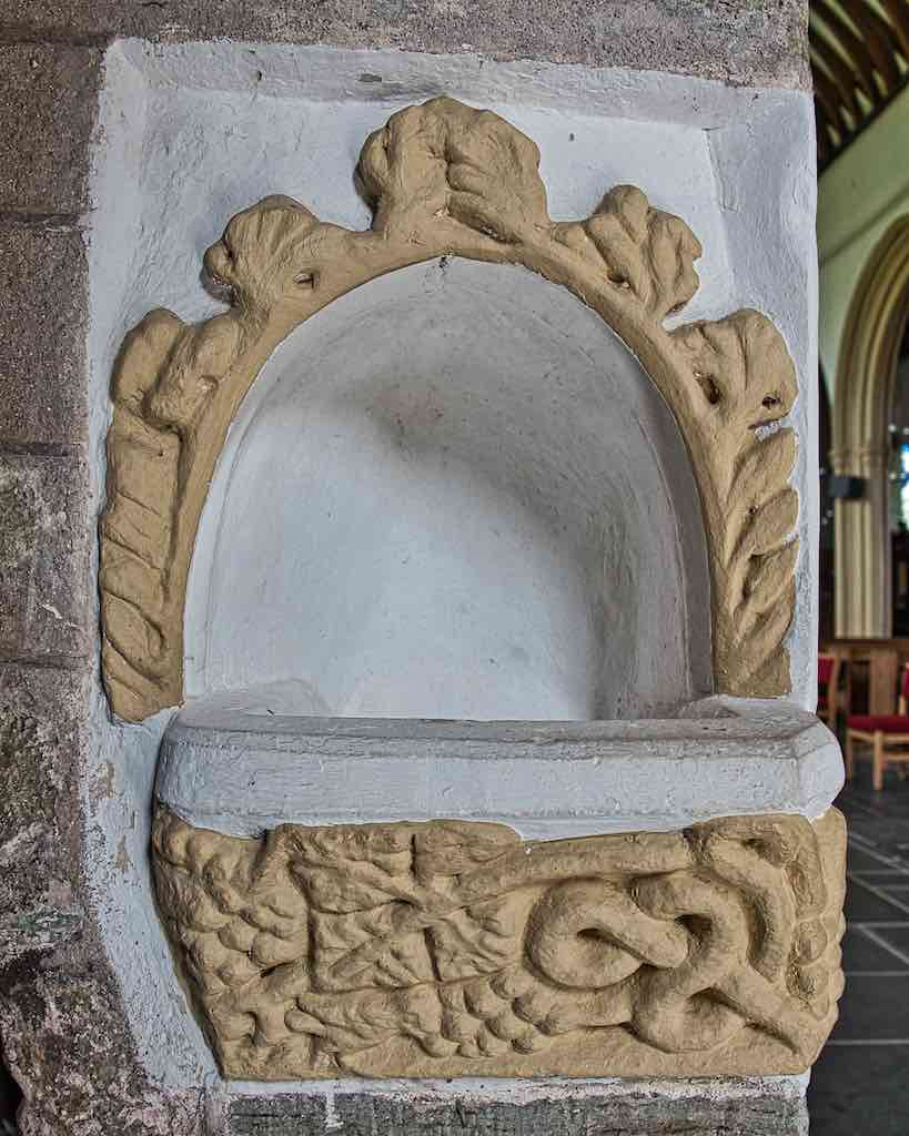 Fragments of medieval carving put together to make a holy water stoup