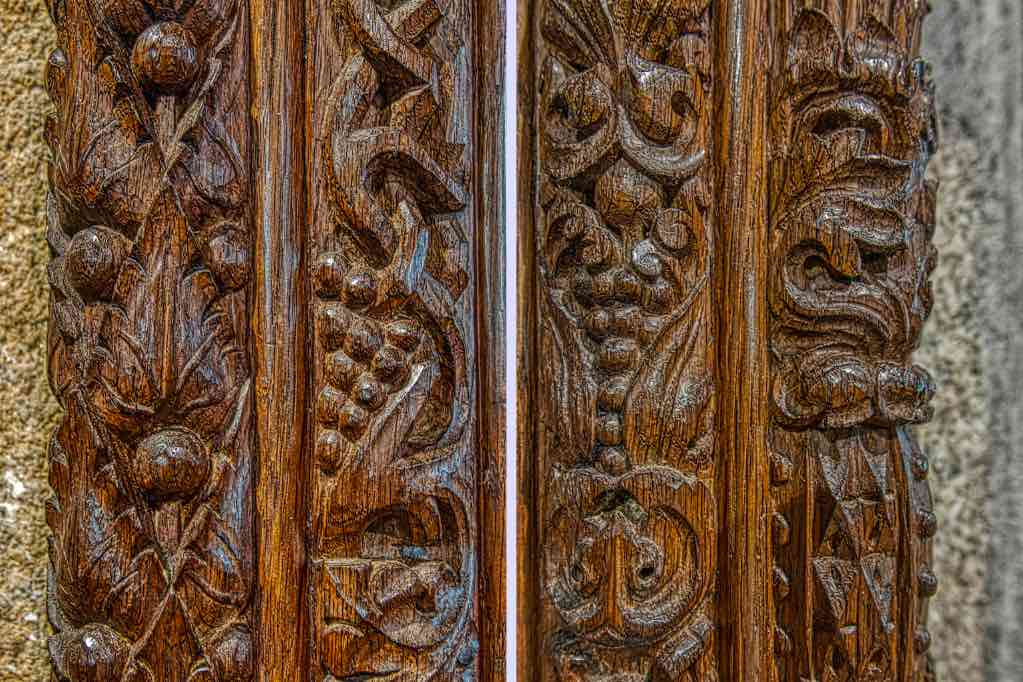 Exquisite carving on the rood screen uprights by the Pinwill Sisters