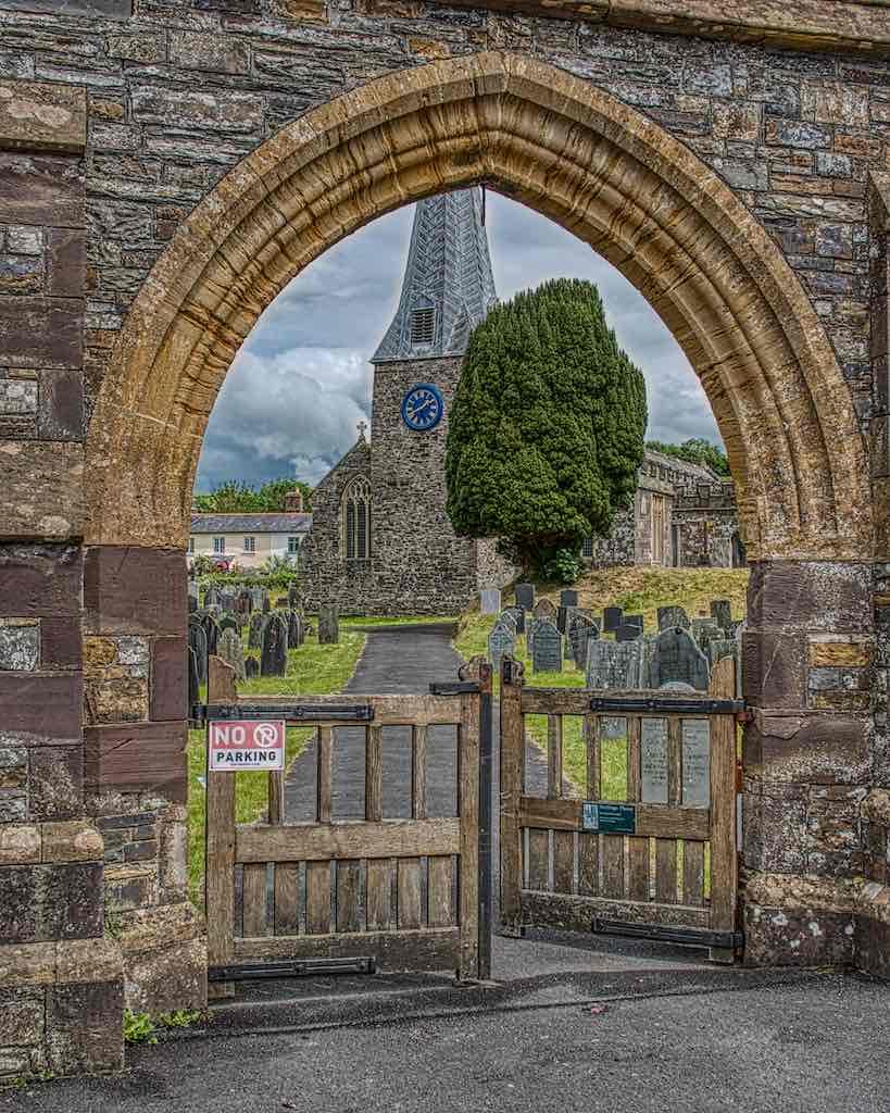 The tower (13th century) and spire (14th century) of Swimbridge church