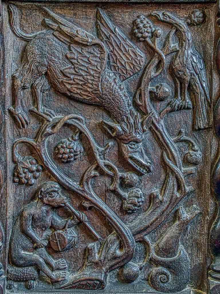 A marvellous 16th century carved panel placed into a chair back in the 19th century