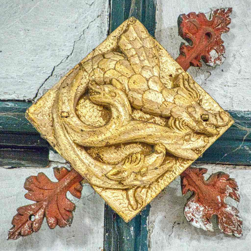 A many-headed beast up in the chancel roof