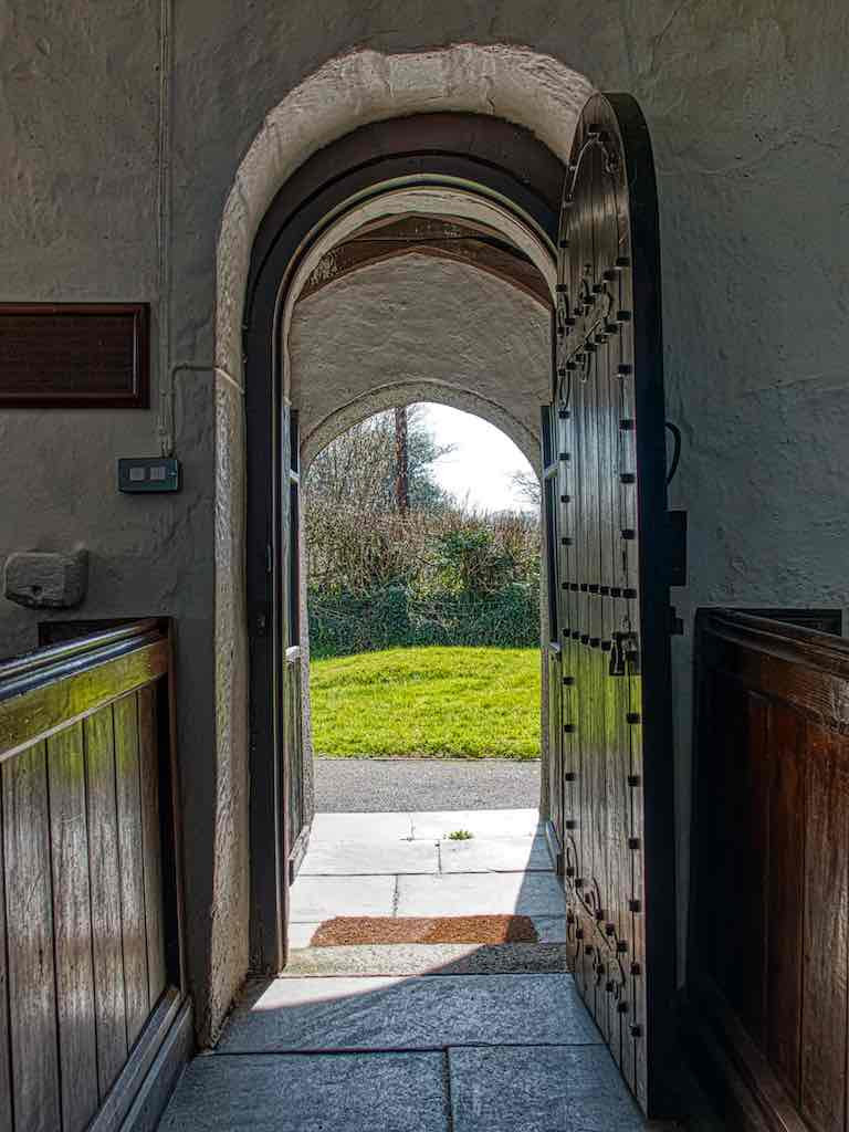 The thinness and the rounded arch shows that that this is most likely a Norman doorway