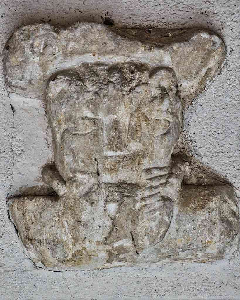 Carved head above the entrance in Membury church