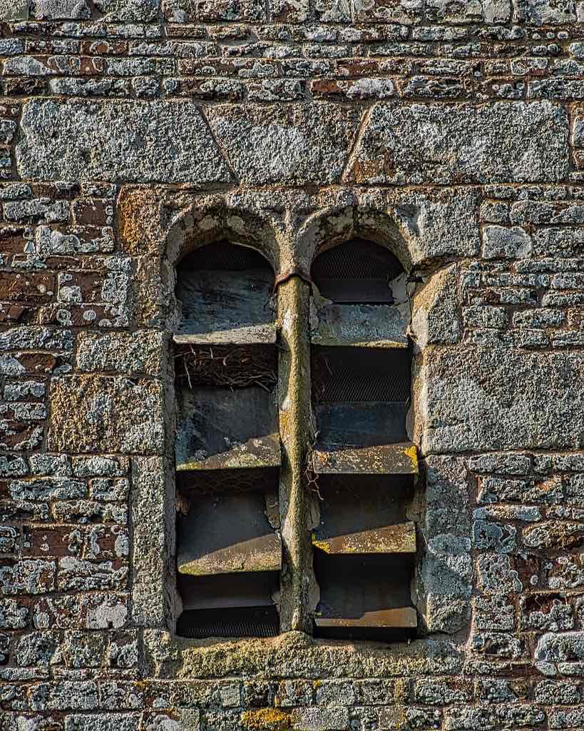 Beautiful stonework around the belfry, lichen included